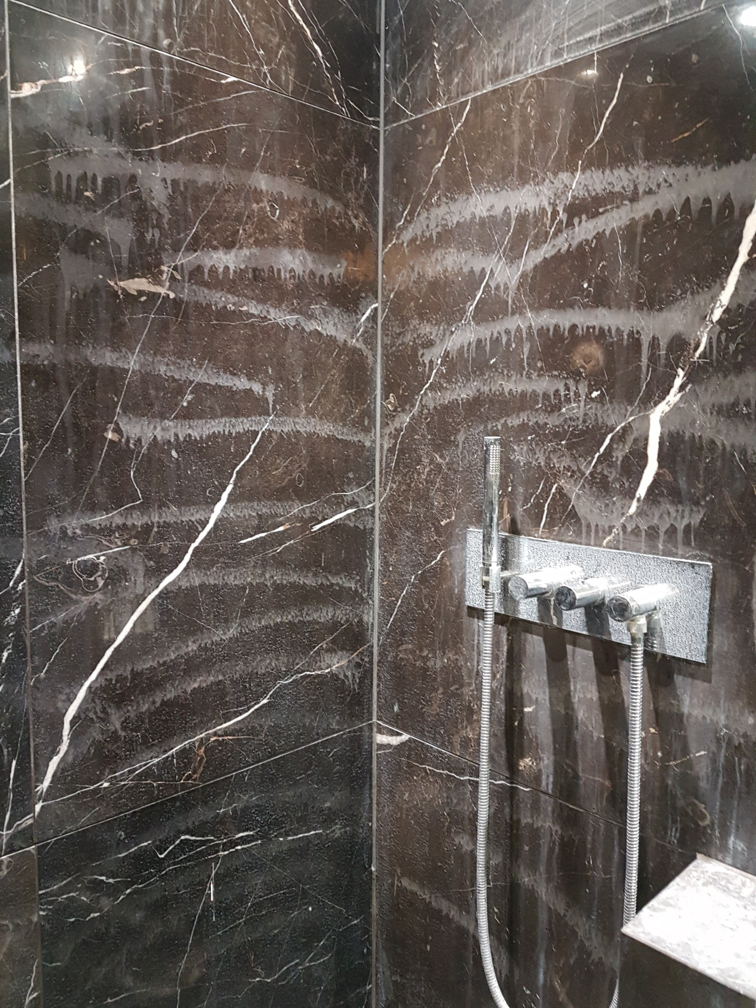 Damaged Marble Shower Wall Before Restoration Ealing