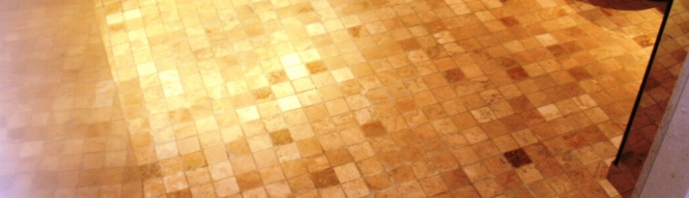 Cleaning a Tumbled Marble mosaic wet room floor in London SE1