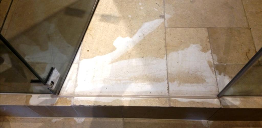 Limestone Floor Damaged by Acid Before Restoration Wapping