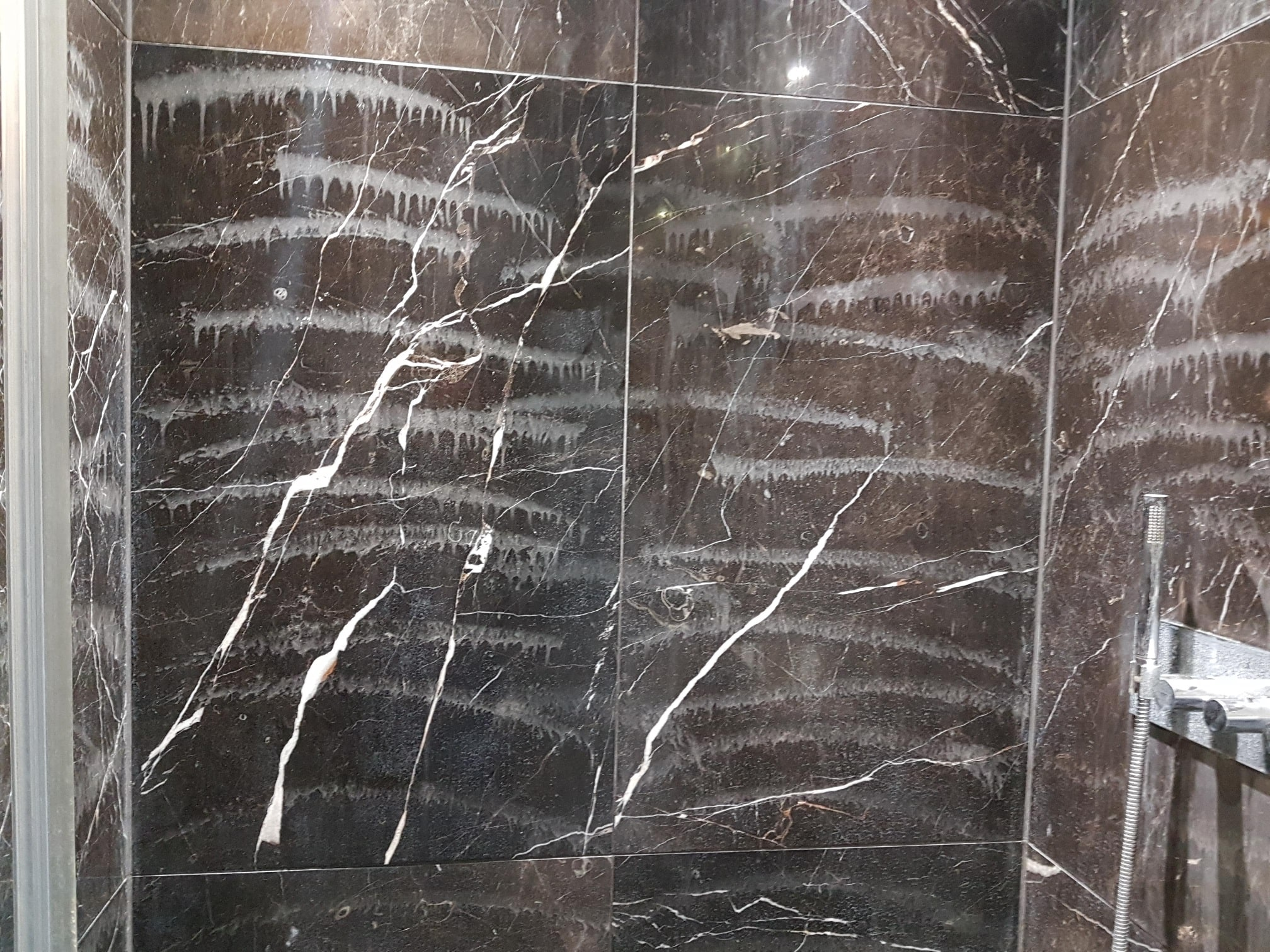 Marble Shower Tiles Damaged by Viakal Limescale Remover